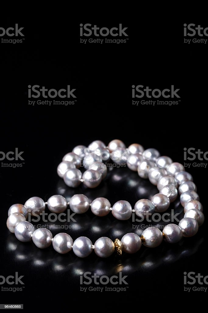 grey pearls on black backgound royalty-free stock photo