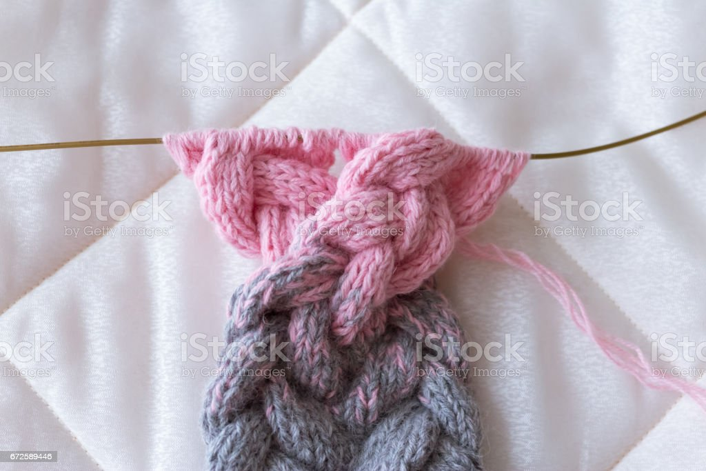 grey pink gradient knit on the needles by hand from wool stock photo