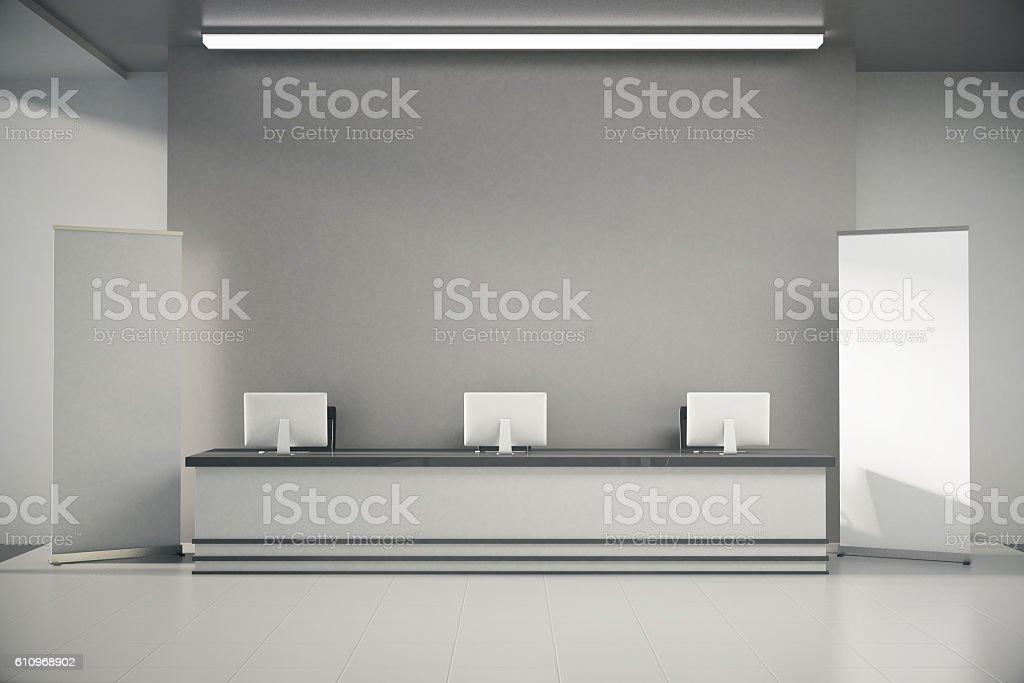 Grey reception desk stock photo