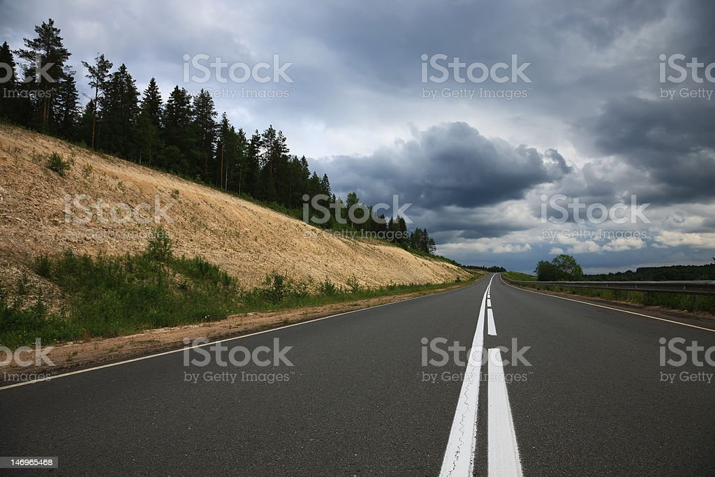 Grey road,  clouds royalty-free stock photo