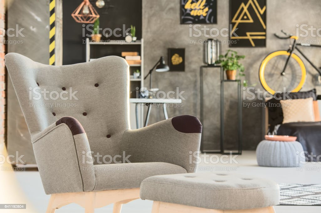 Grey room with stylish upholstered chair stock photo
