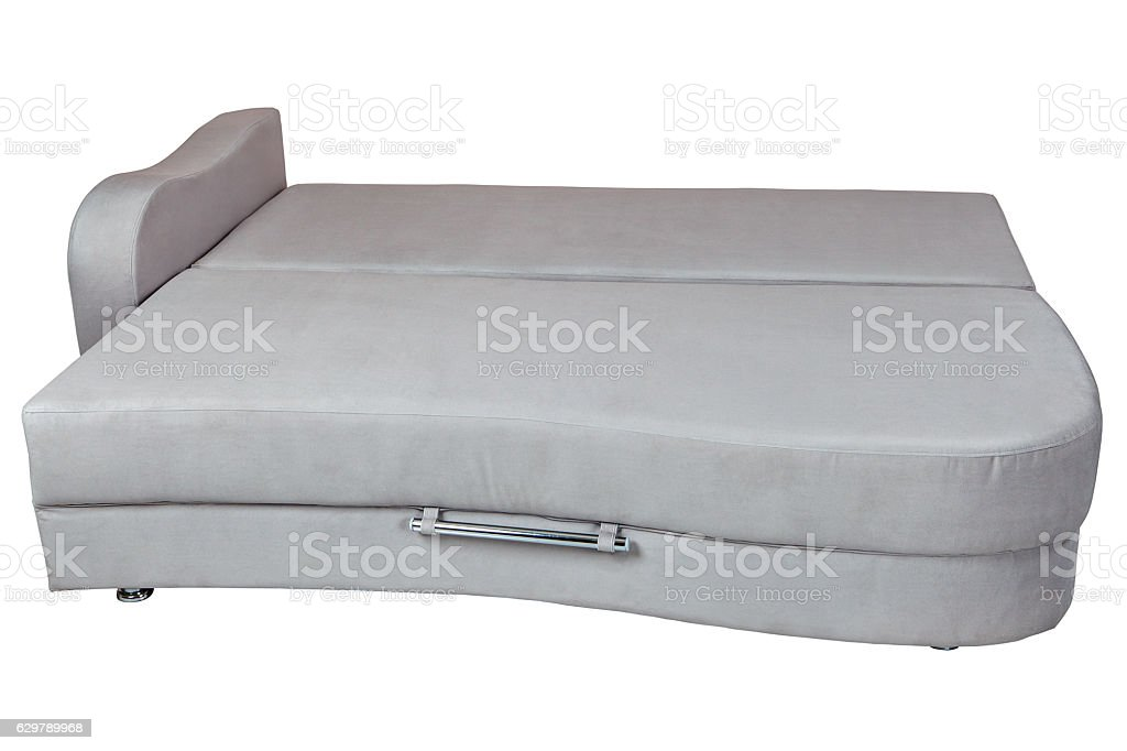 Grey sofa bed with storage for bedding, isolated on white. stock photo