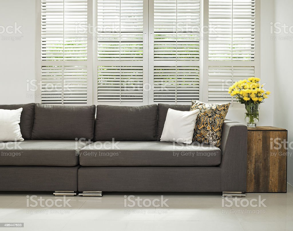 Grey sofa in simple setting stock photo