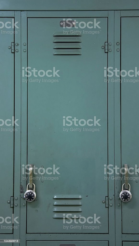 Grey steel locker with combination lock on it stock photo