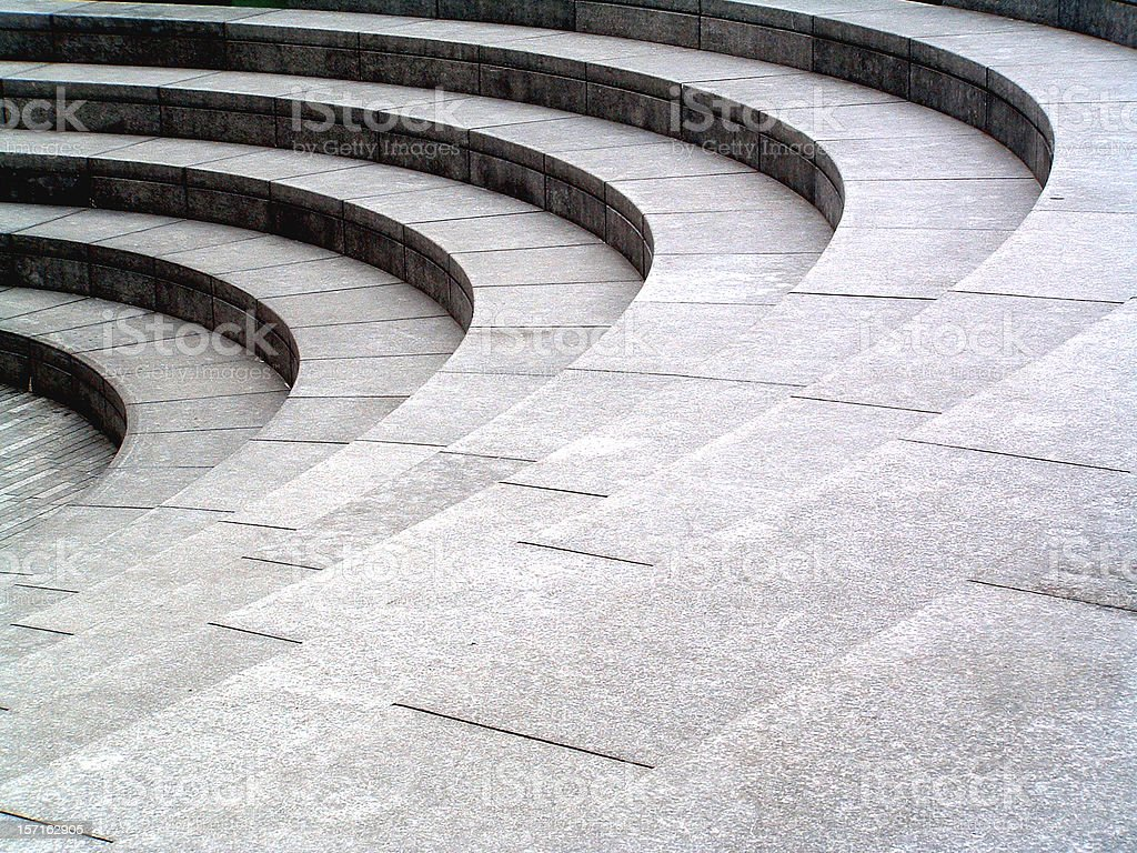 Grey stone, granite curved steps background texture stock photo