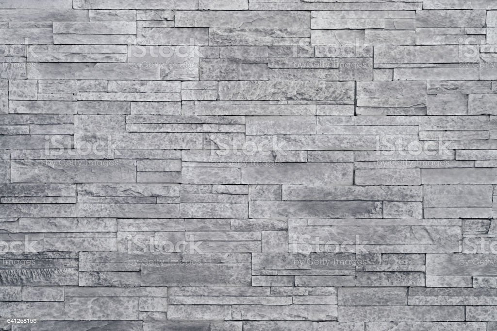 Grey stone wall background stock photo