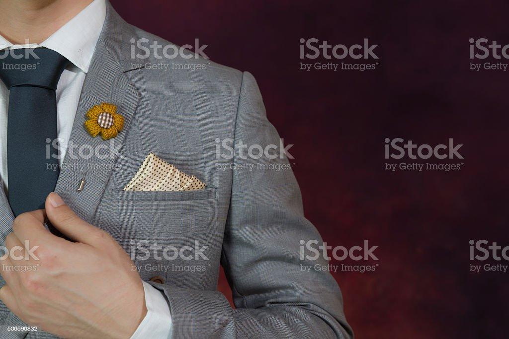 grey suit plaid texture, necktie, brooch, handkerchief stock photo