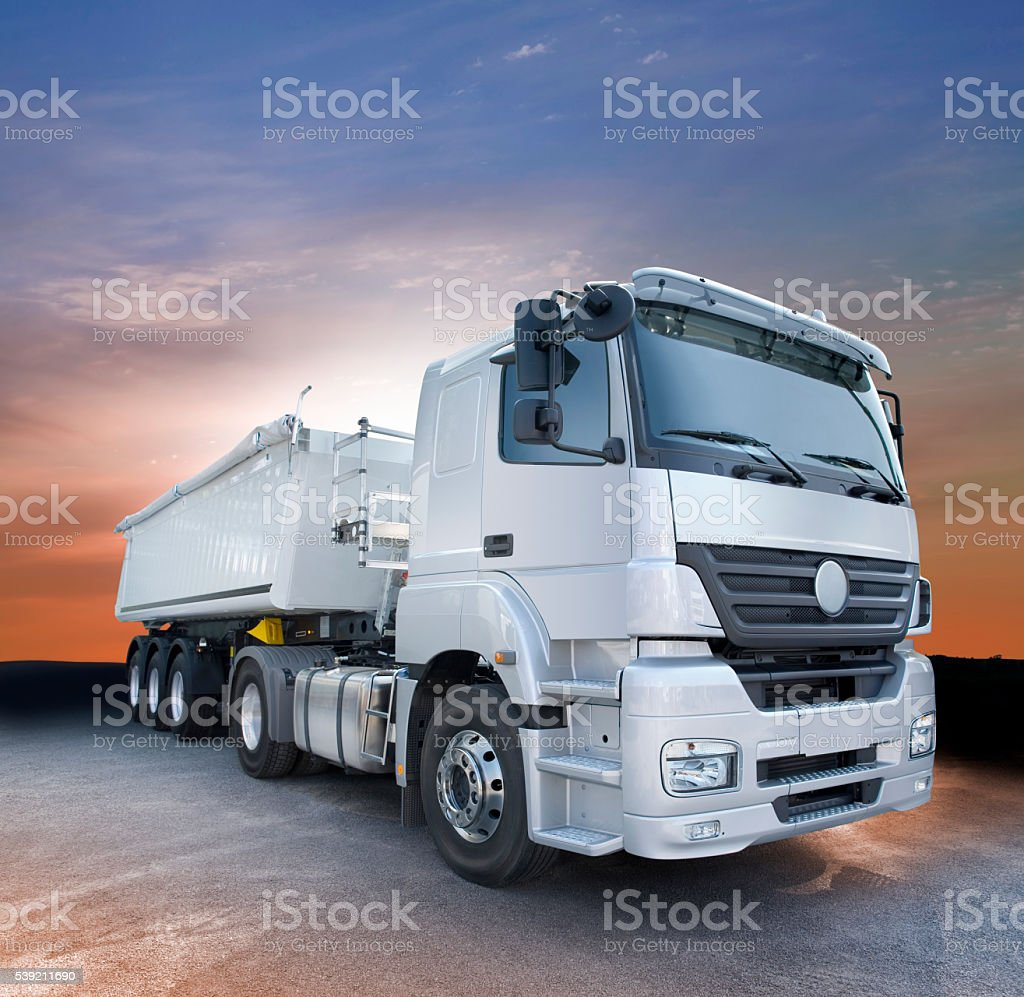 Grey truck at down standing on road stock photo