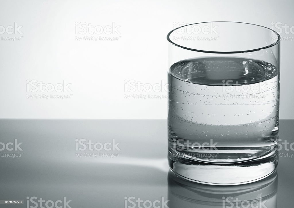 Grey water glass with bubbles stock photo