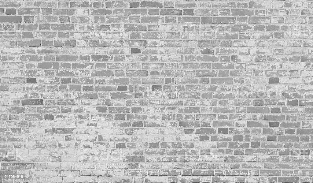Grey white old brick wall. stock photo