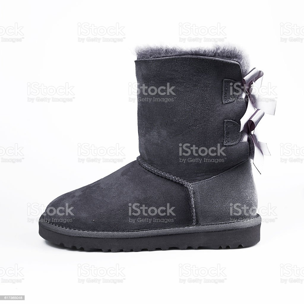grey winter shoes over white stock photo