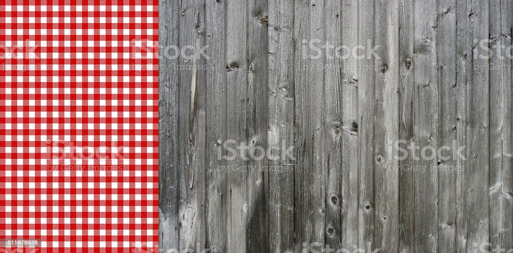 Grey wood and red white tablecloth stock photo