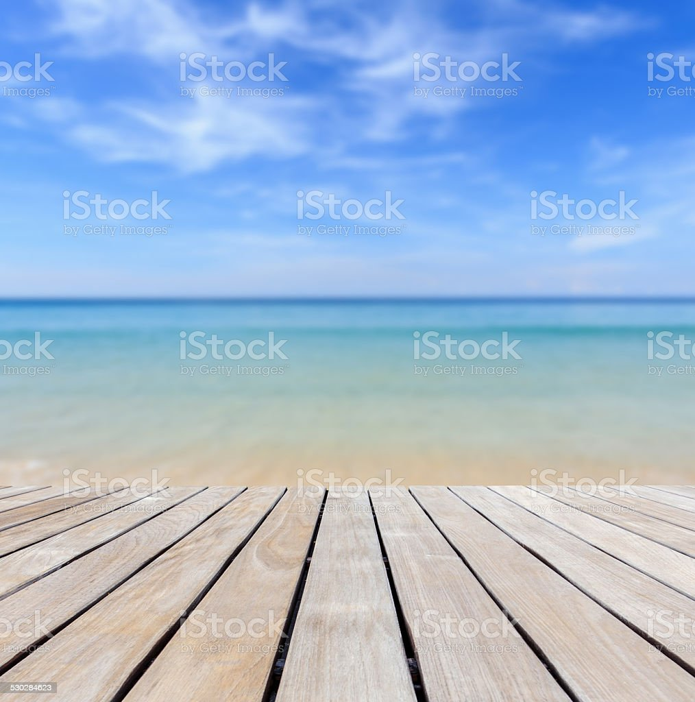 Grey wood decking and tropical beach stock photo