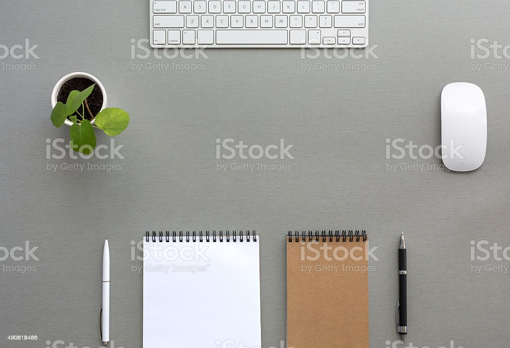 Grey Wooden Desk with Stationery and Electronics stock photo