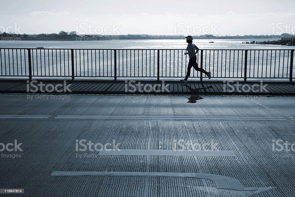 Greyscale photo of a silhouetted jogger royalty-free stock photo