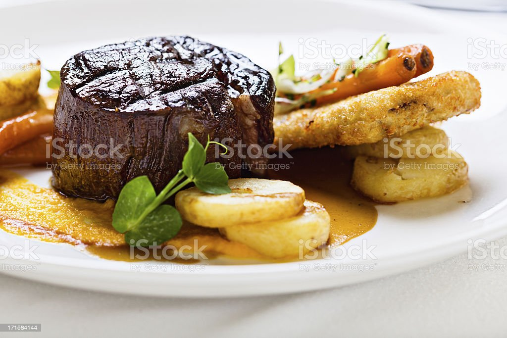 Griddled fillet steak with glazed vegetables stock photo