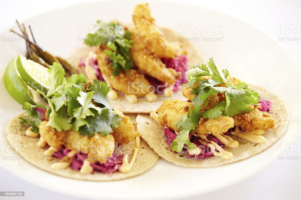 Griddled mahi fish tacos, cilantro and lime on corn tortillas royalty-free stock photo