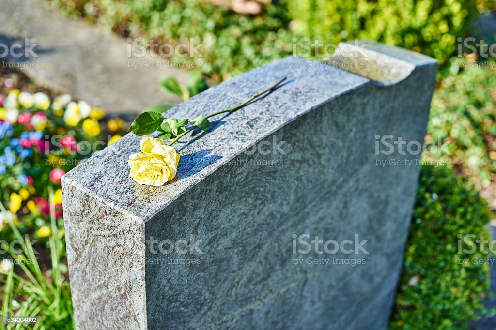 grief at on cemetery stock photo