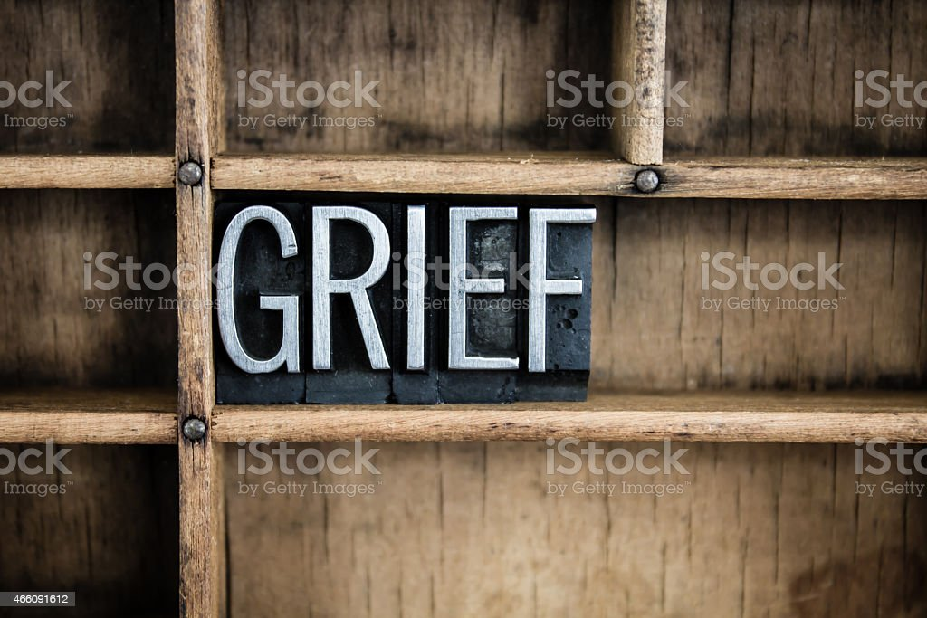 Grief Concept Metal Letterpress Word in Drawer stock photo