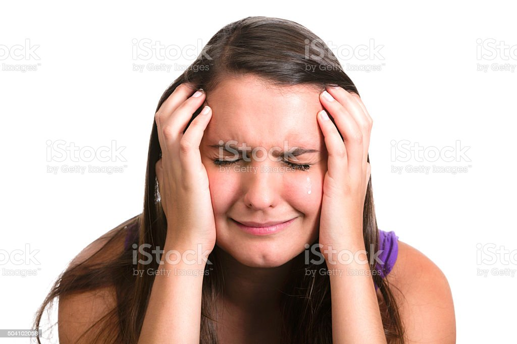 Grief, sorrow. Crying and sad Hispanic young woman with teardrops stock photo