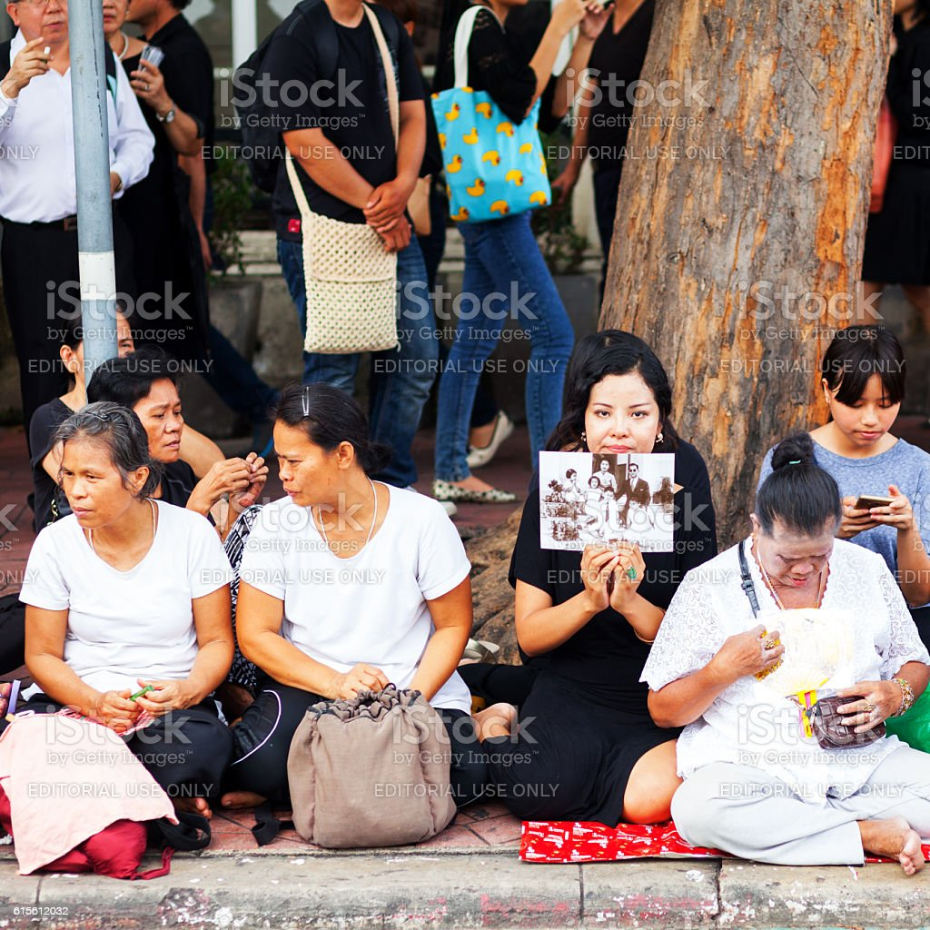 Griefing thai women with image of King Bhumipol stock photo