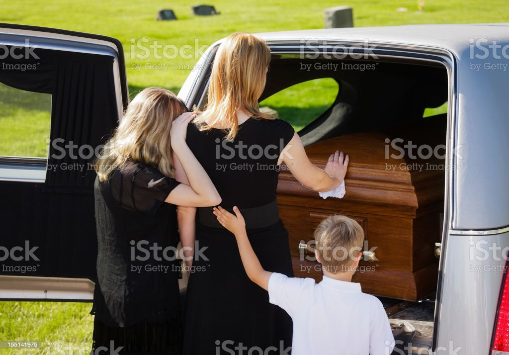 Grieving Family at a Funeral stock photo