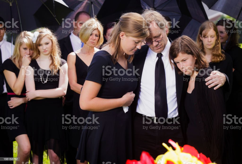 Grieving Father and Daughters stock photo