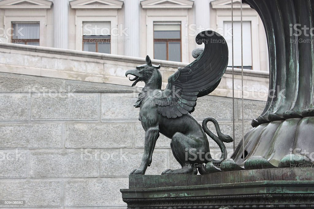 Griffin sculpture before the parliament building in Vienna, Austria. stock photo