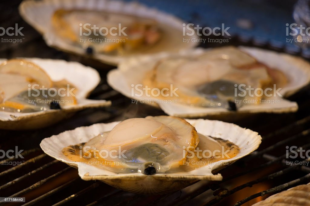 Grill and burn oysters on flaming fire at Hokkaido market stock photo