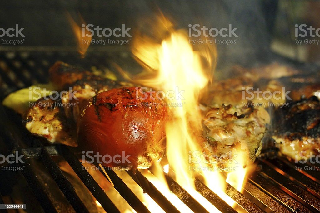 Grill chicken pieces with tomato. stock photo