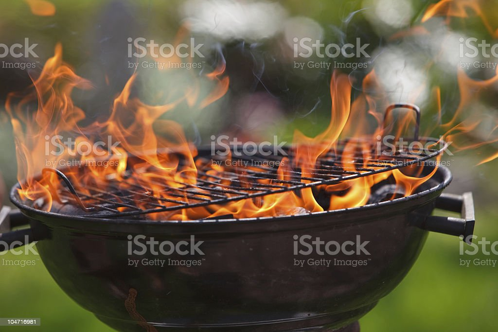 Grill in fames stock photo