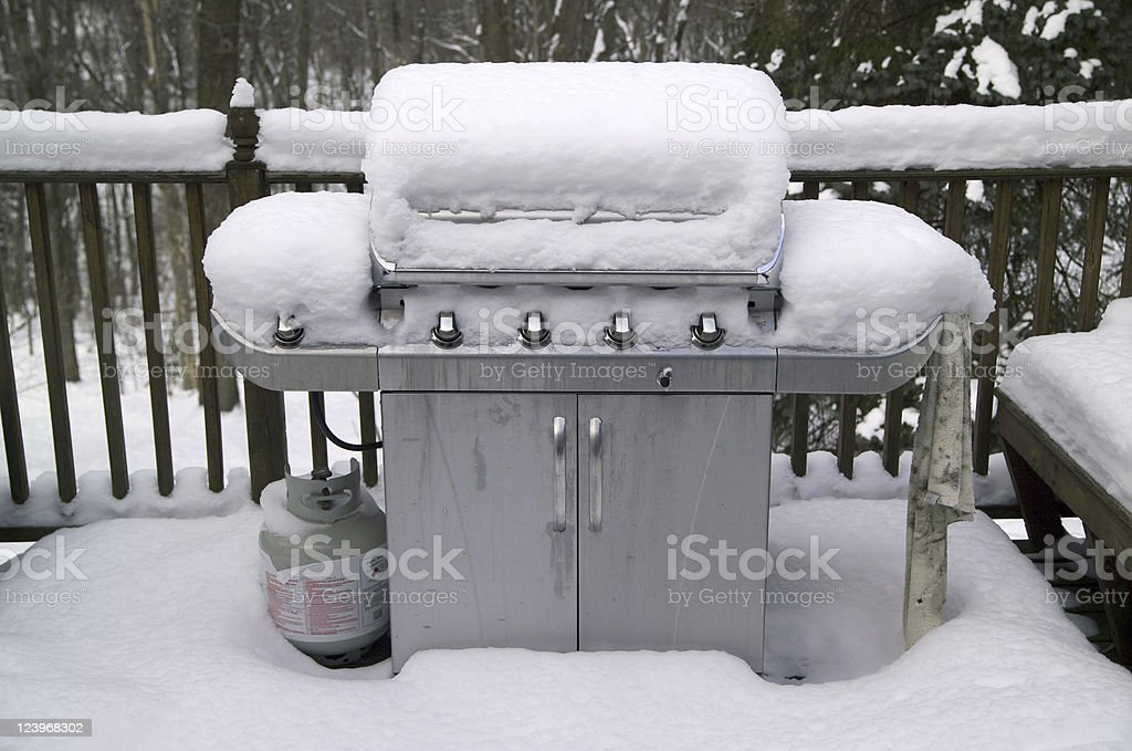 Grill in snow stock photo
