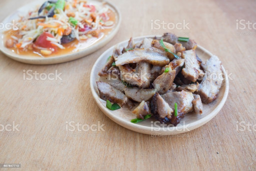 Grill neck pork eating with papaya salad or som-tam Thai local food stock photo