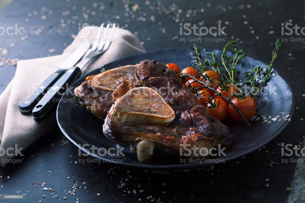 Grill ossobuco with spices and thyme stock photo