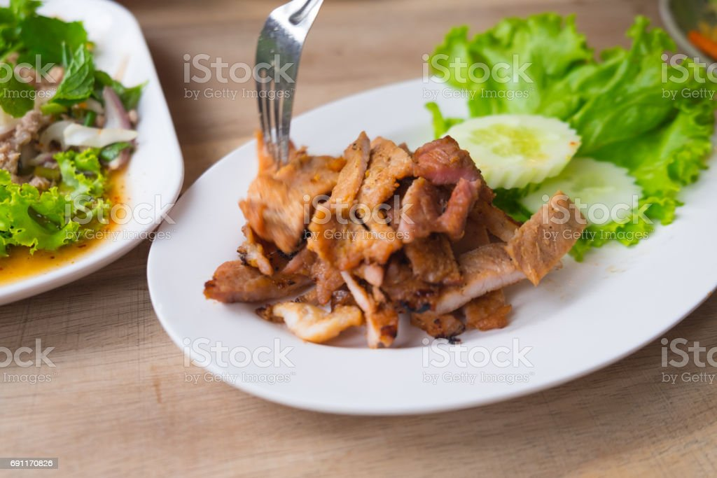 Grill pork (Thai style food) on wooden table stock photo