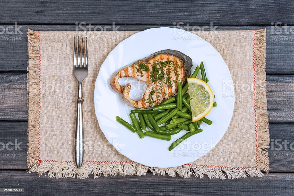 grill salmon steak on the plate top view stock photo