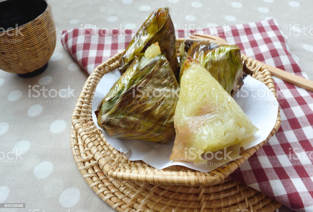 Grill sticky rice with taro wrapped in banana leaf stock photo