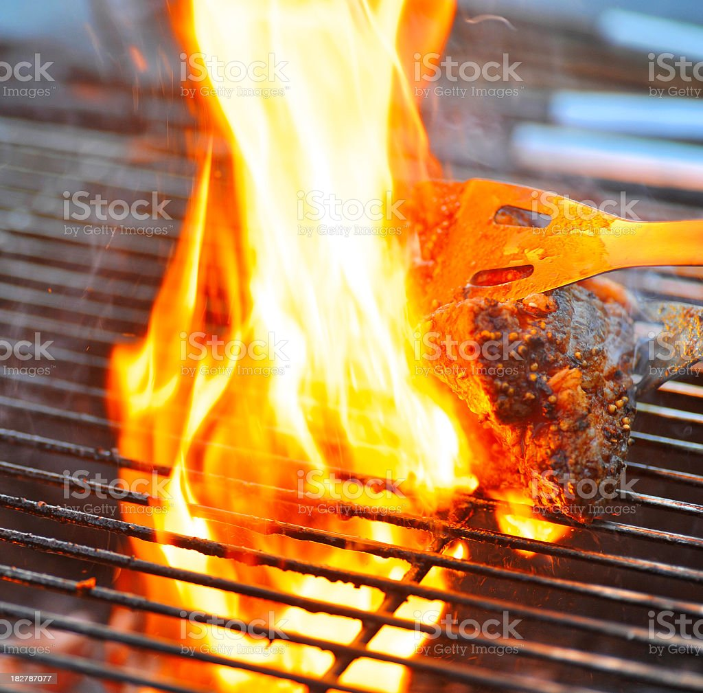 grill with fire and steak royalty-free stock photo