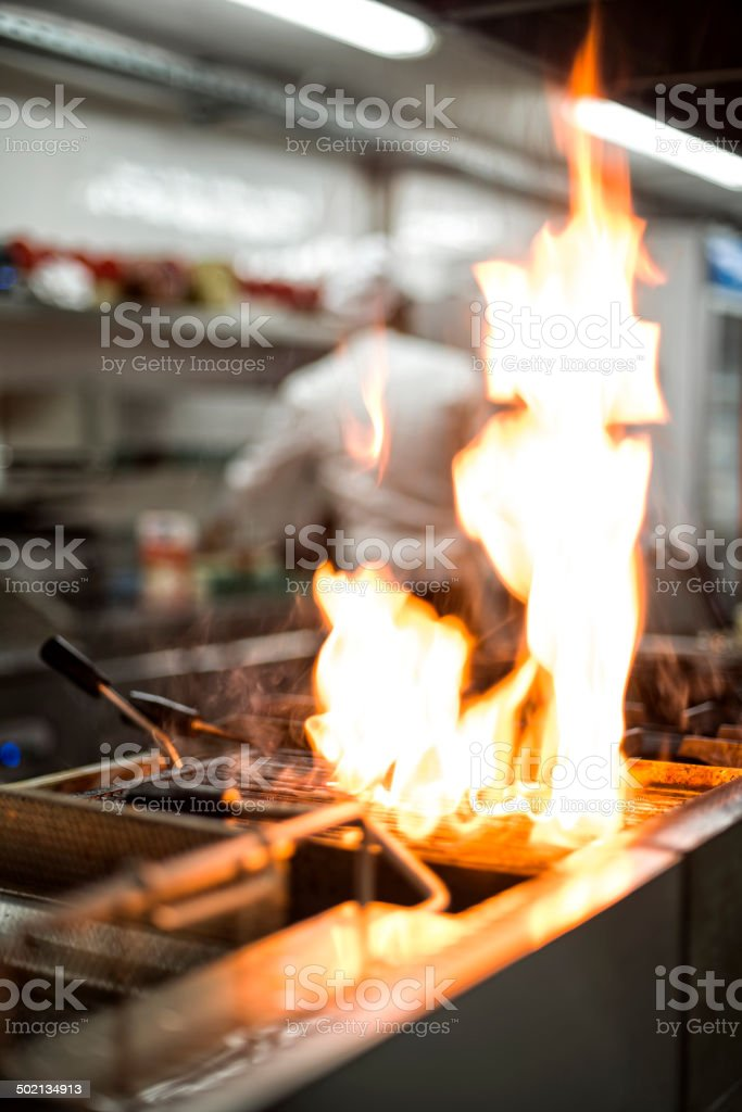 Grill with flames stock photo