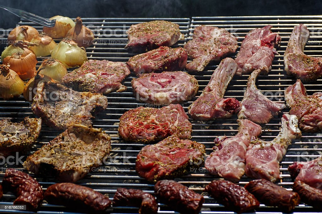 Grill with meat and onions stock photo