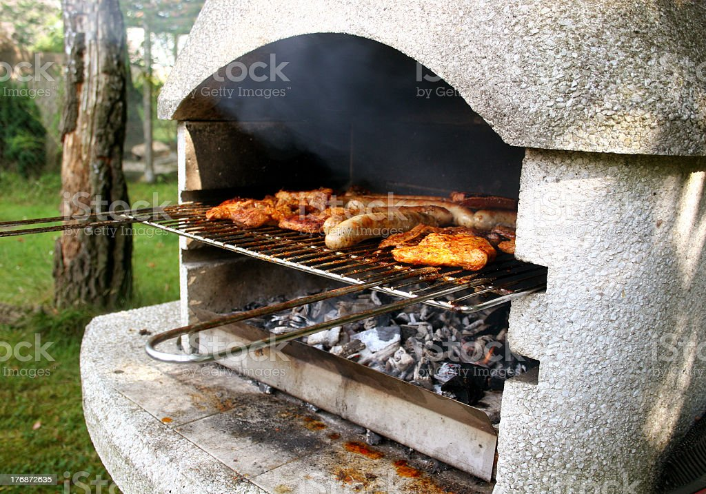 Grill with steaks and sausages royalty-free stock photo
