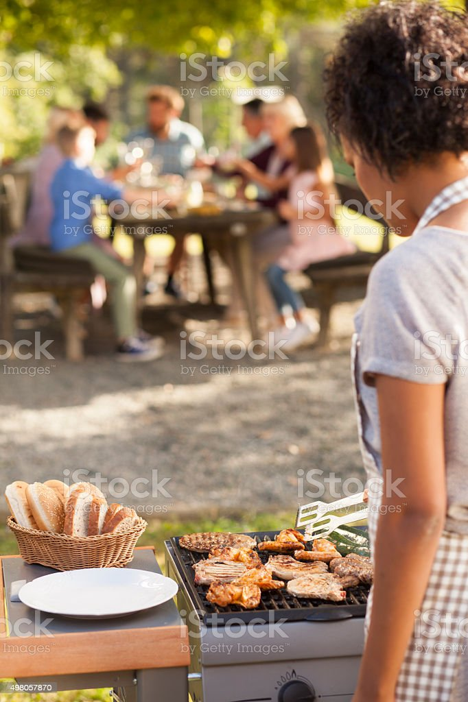Grill with whole family stock photo