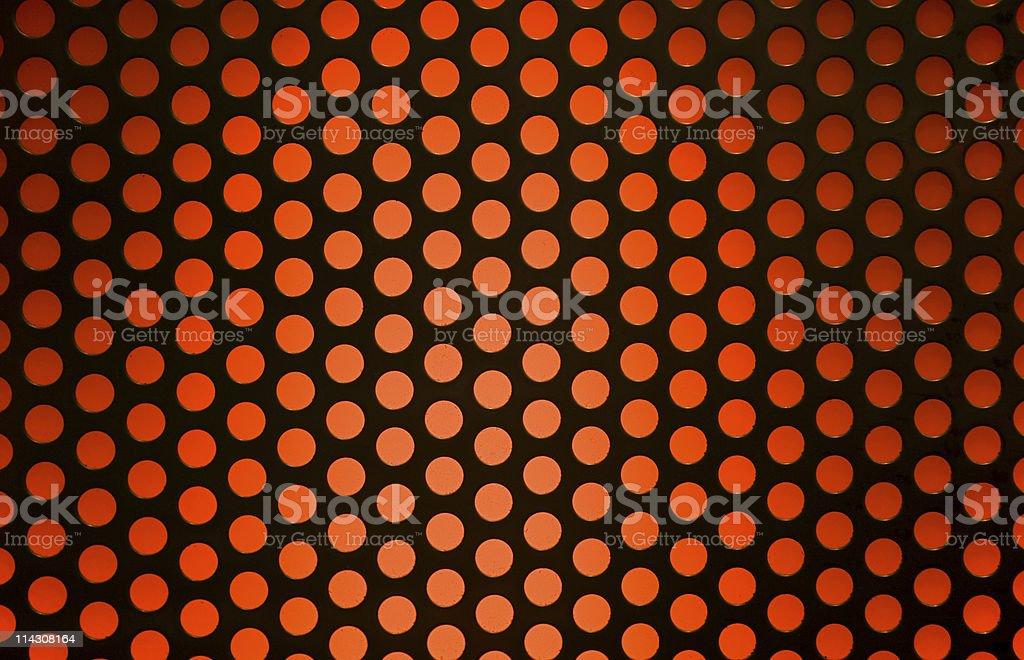 Grille over orange light stock photo