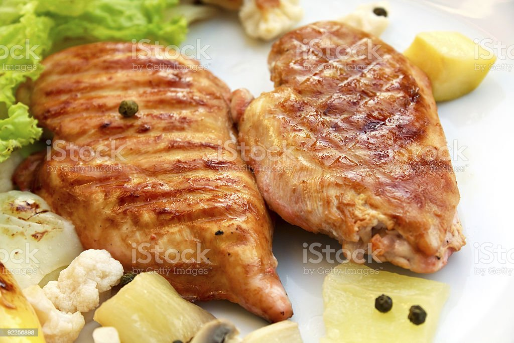 Grilled and roasted schnitzel turkey meat and veggies stock photo