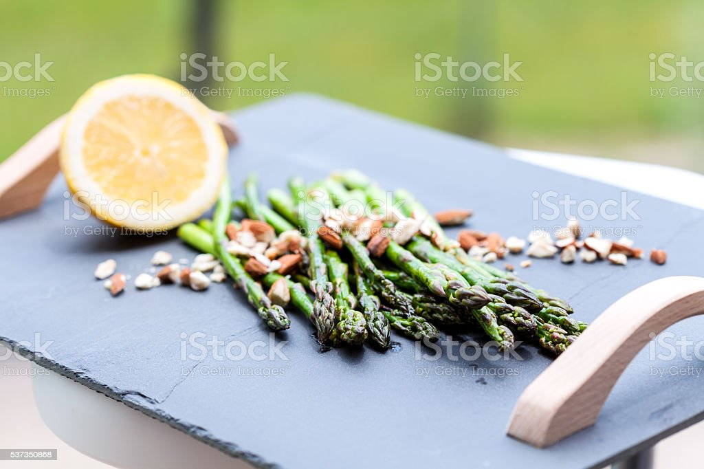 Grilled asparagus on slate plate stock photo
