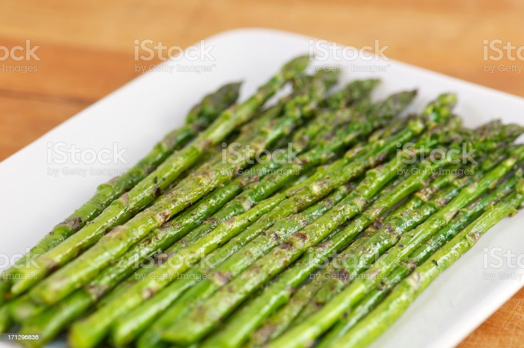 Grilled Asparagus on White Plate using Selective Focus stock photo