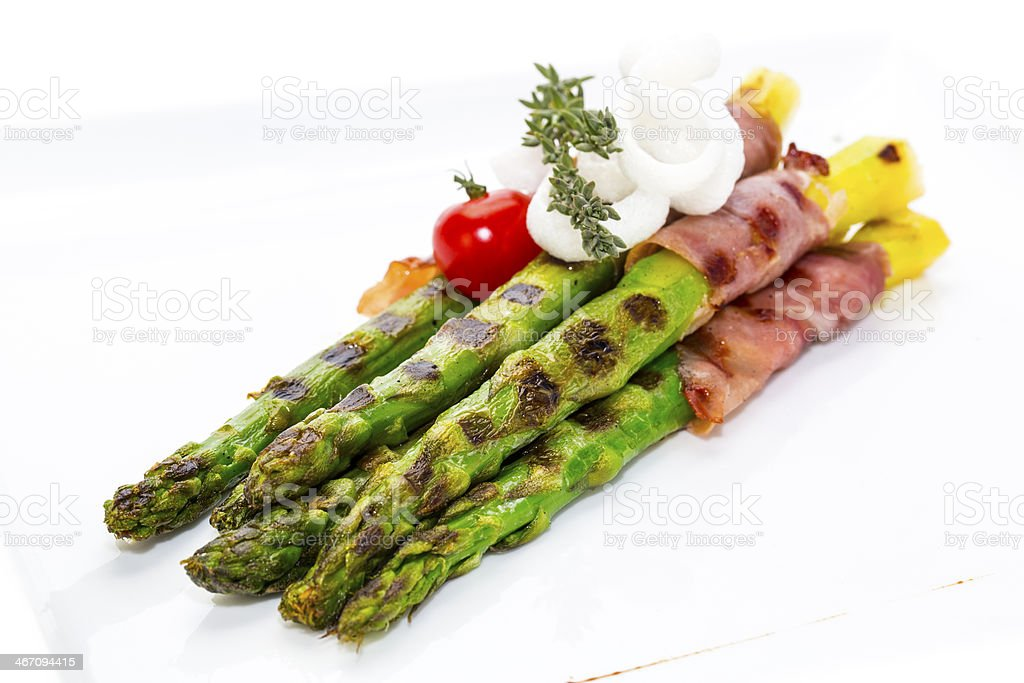 grilled asparagus with bacon and sauce royalty-free stock photo