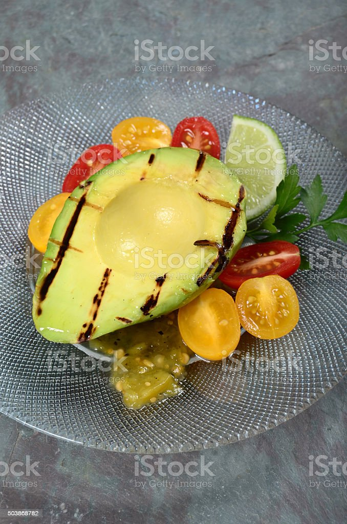 Grilled Avocado With Tomatoes and Salsa stock photo
