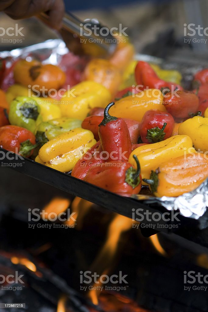 Grilled Baby Bells with tongs stock photo