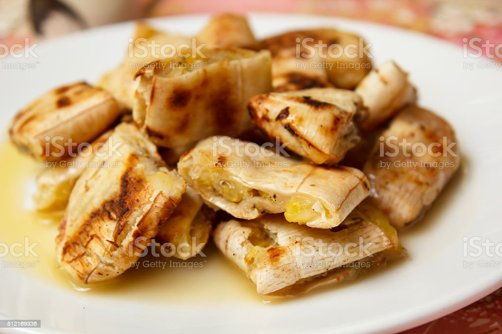 Grilled banana serve with syrup. stock photo